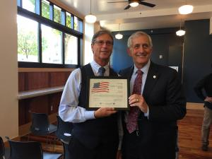 Andy Dean, veteran and former Princeton Property Management employee with Mayor Hales. Princeton Property Management was awarded for their work in providing units to homeless Veterans in need.