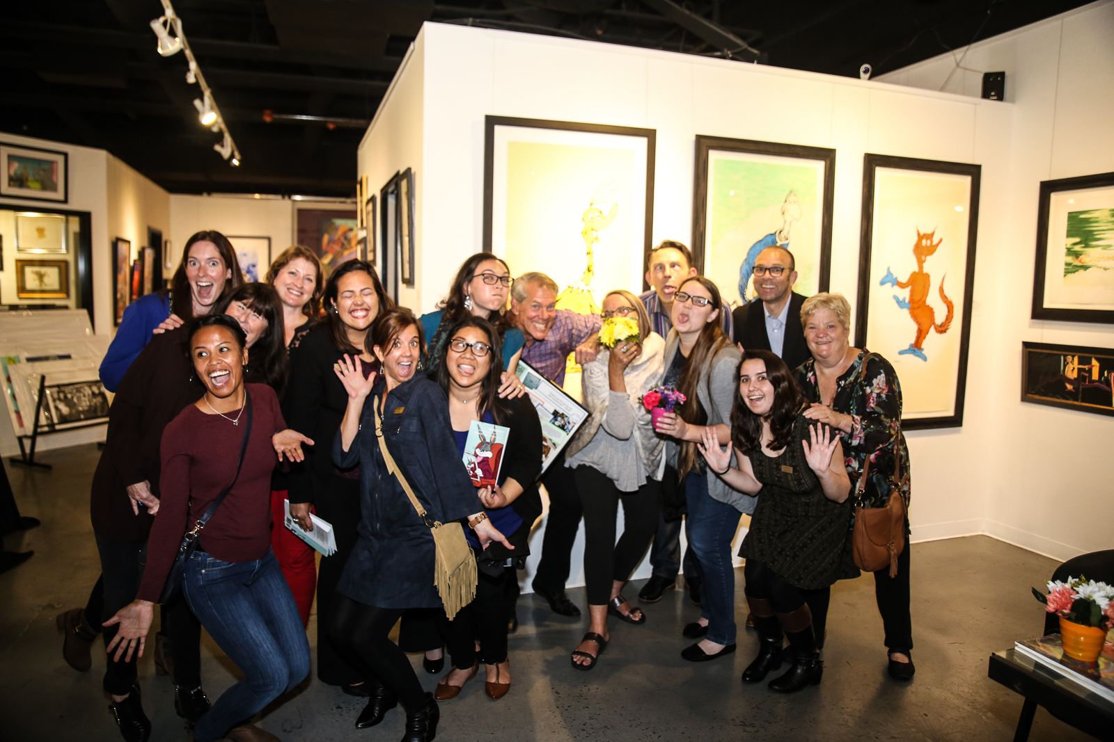 Say Cheese! Chuck Jones Center for Creativity and Words Alive staff and volunteers celebrate the students' work at the exhibit.