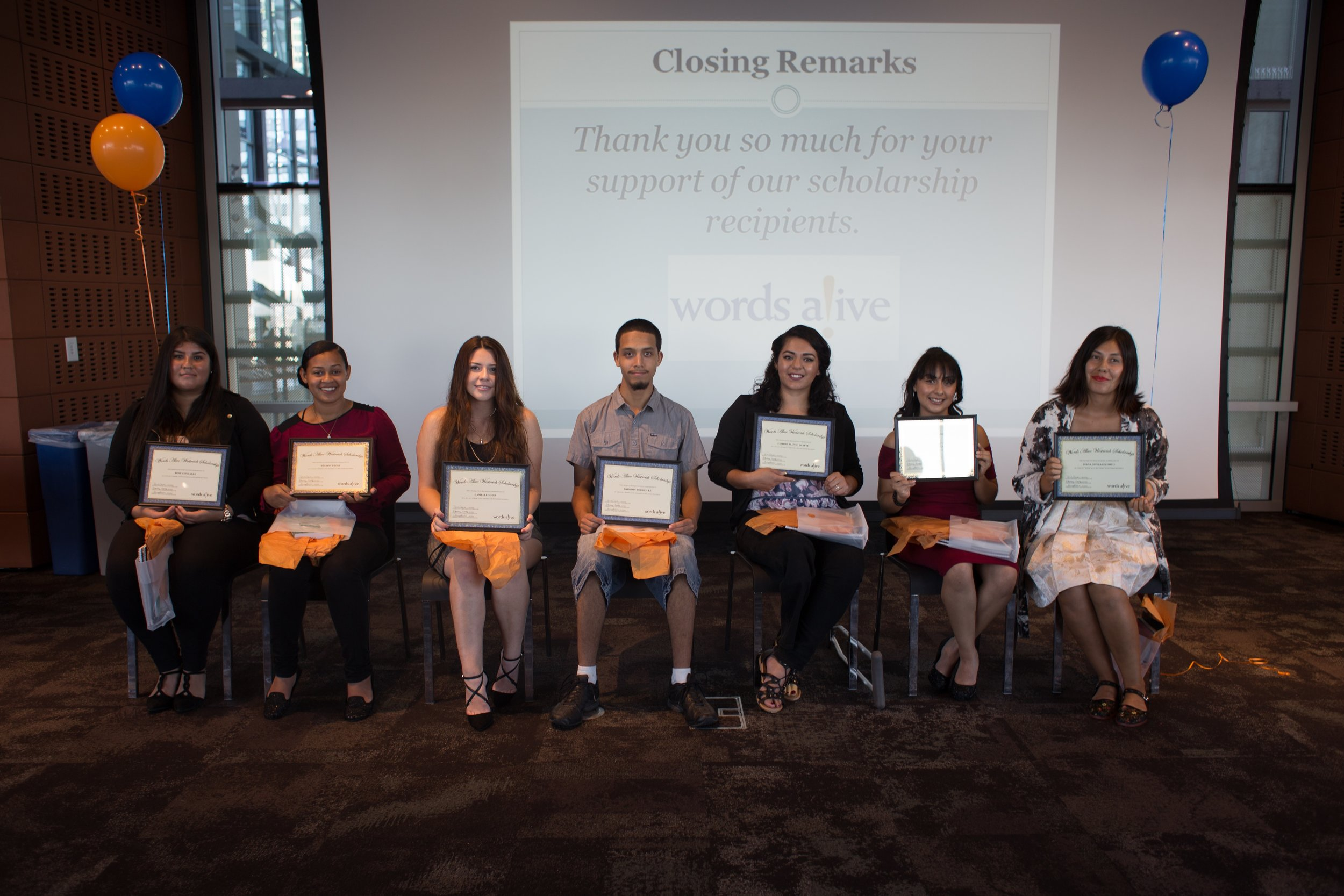 Image: Seven of the Words Alive Westreich Scholarship Students sit in a row displaying their awards at last year's Scholarship Ceremony.