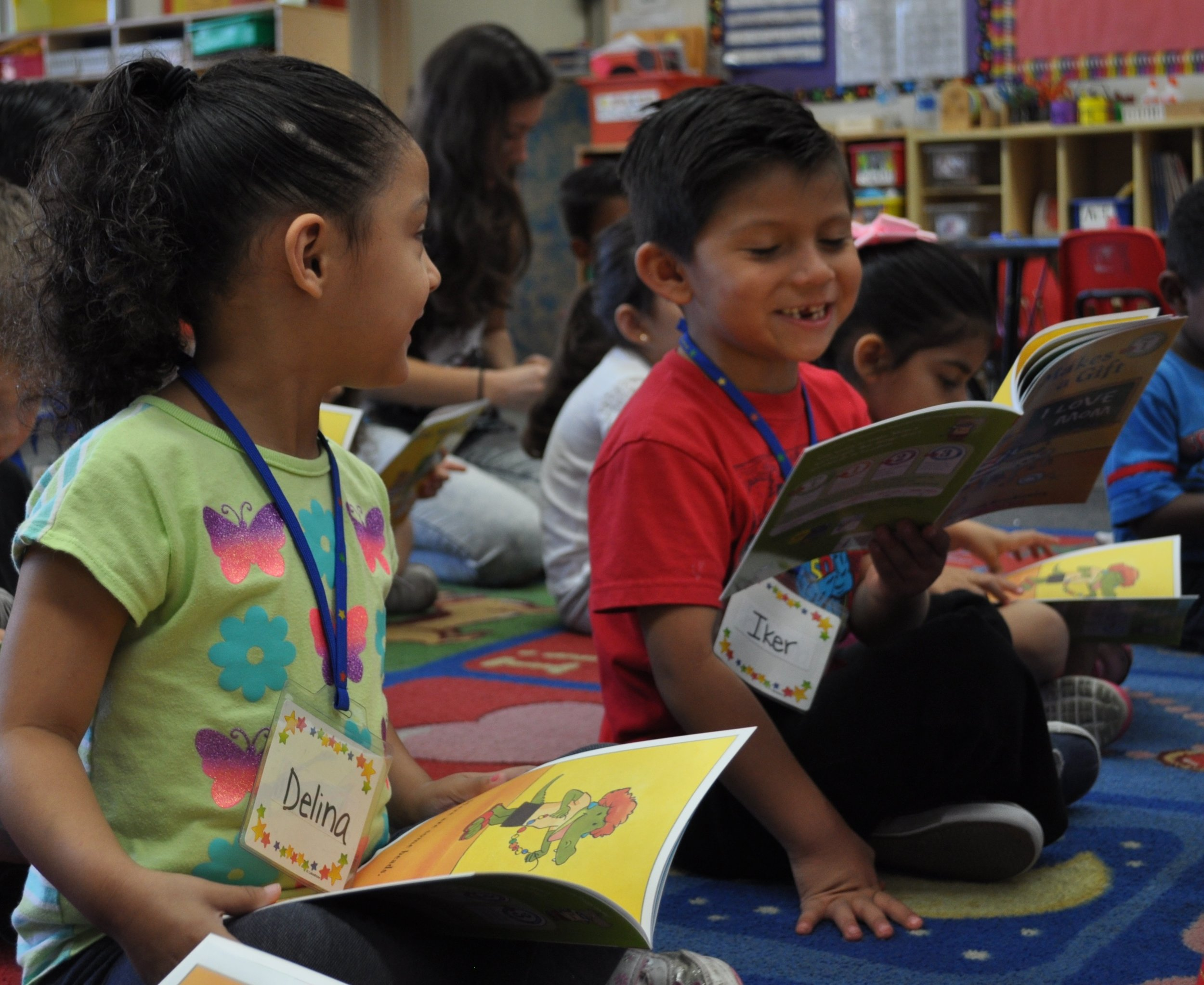 A picture of two elementary school students in our Read Aloud Program exploring a book together!