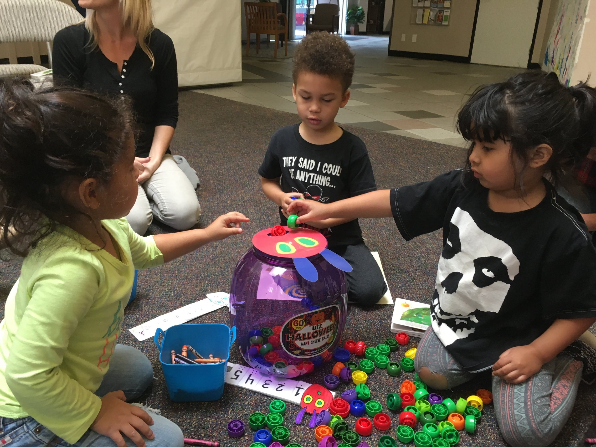 Children in our Family Literacy Program practice skills like counting, rhyming, and color recognition by participating in fun activities!