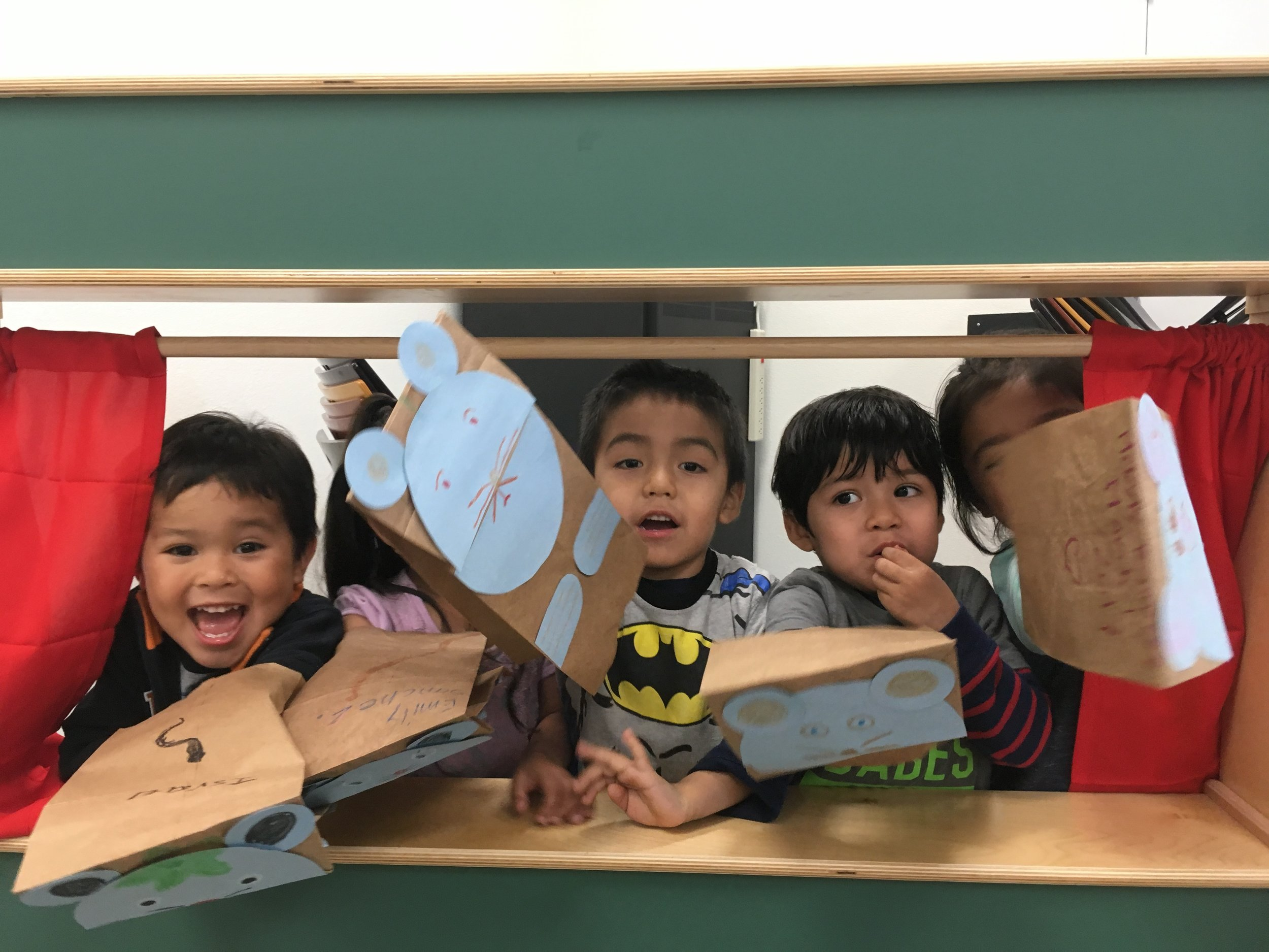 A picture of some children in our Family Literacy Program! They are posing with puppets they made during the FLP session.