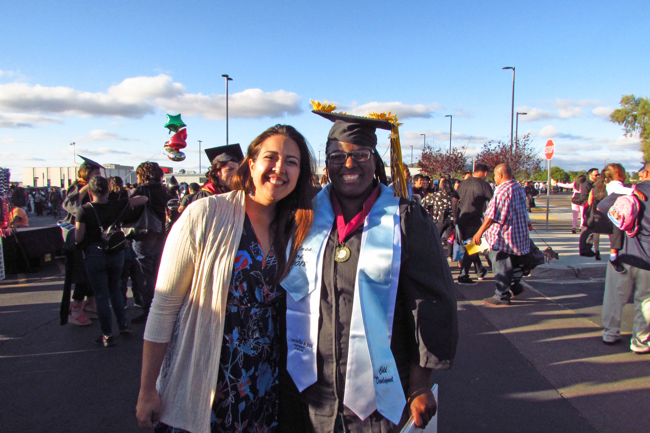 An image of Jessica Fryman, Teen Services Program Manager, and Domminice Willis at the graduation!