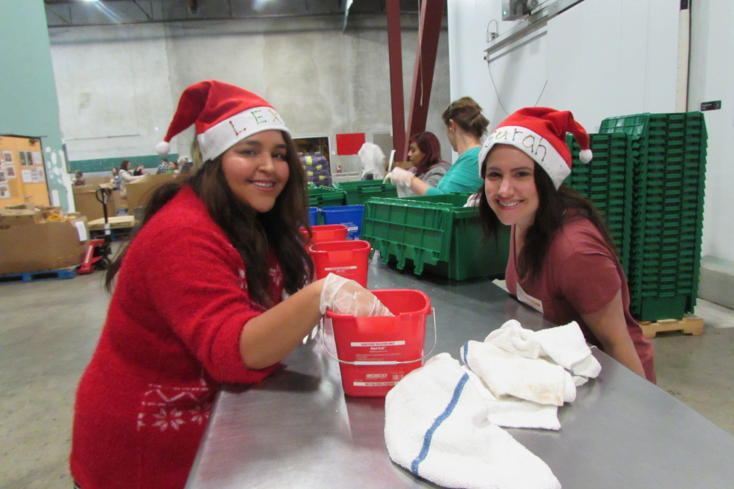 A picture of Lexi working with her mentor, Sarah Beauchemin, at an event at Feeding San Diego!