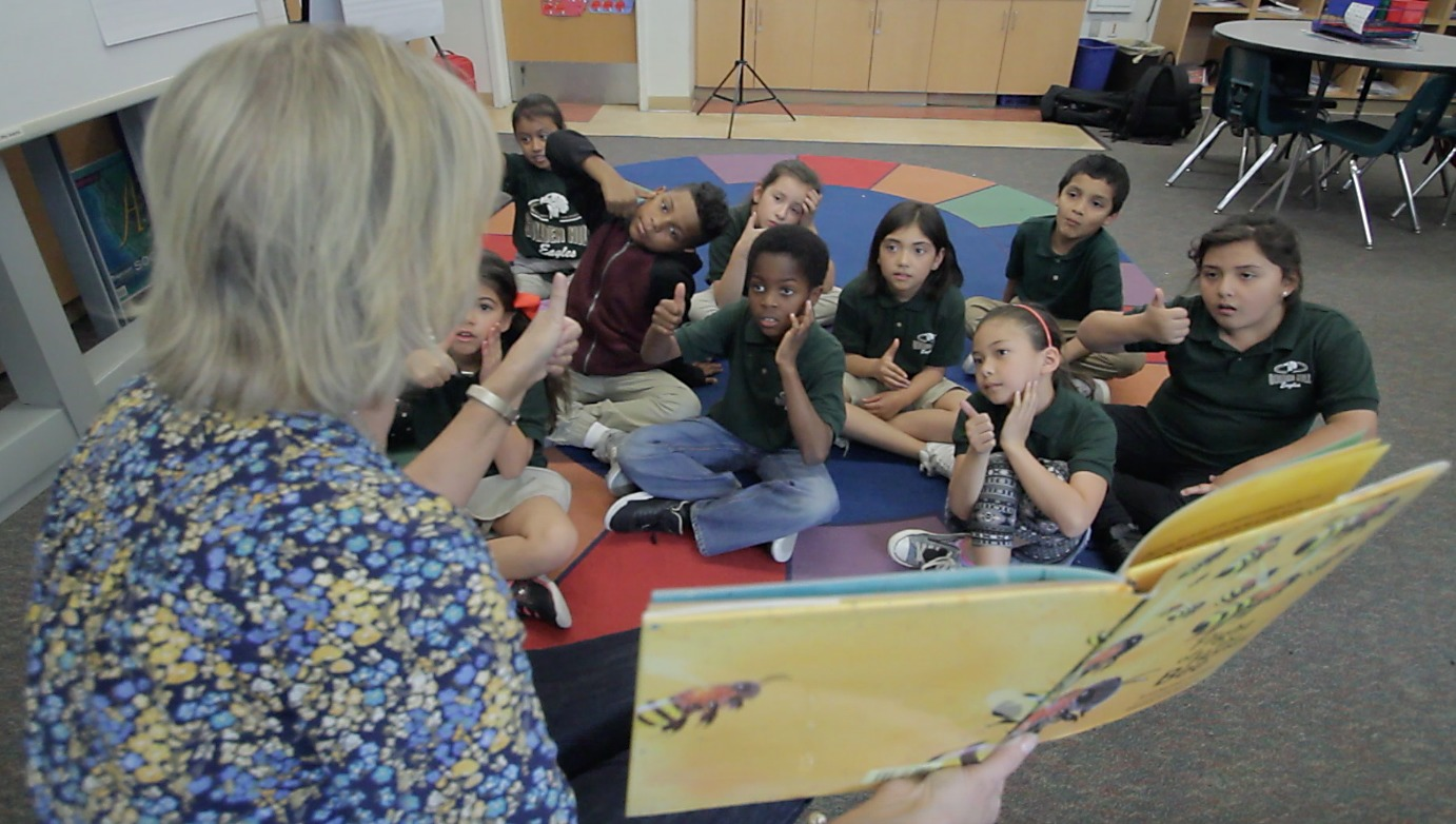 An image of one of our Read Aloud Program volunteers reading to a classroom at Golden Hill School.