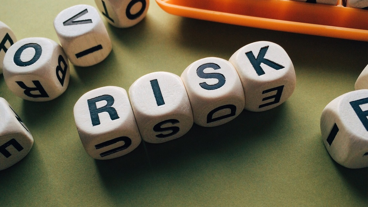 "An image of four dice spelling out the word ""risk."" The word ""hazard"" originated from an Arabic word for a dice game that involved high risk!"