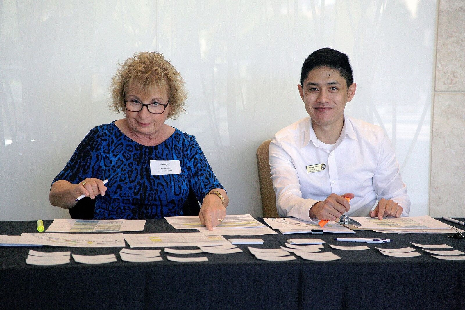 An image of John sitting at a table with a fellow volunteer at this year's Author's Luncheon & Fundraiser!