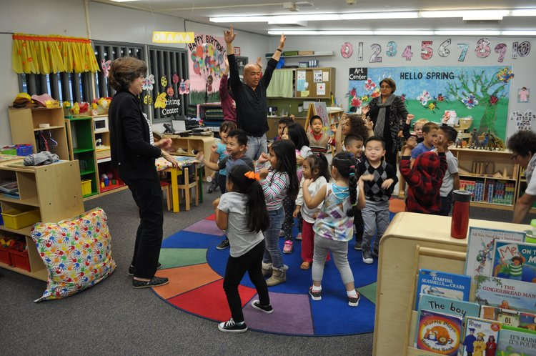 A picture from 2017's Share Your Love of Reading campaign! The VIP reader had students get up and dance!