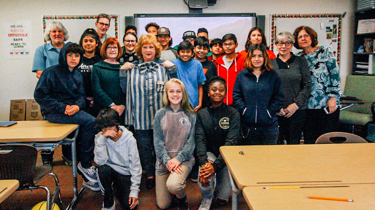 A group picture of The Butterfly Project presenters with Stephen Keiley's 8th grade class at Monarch School and Words Alive ABG volunteers.