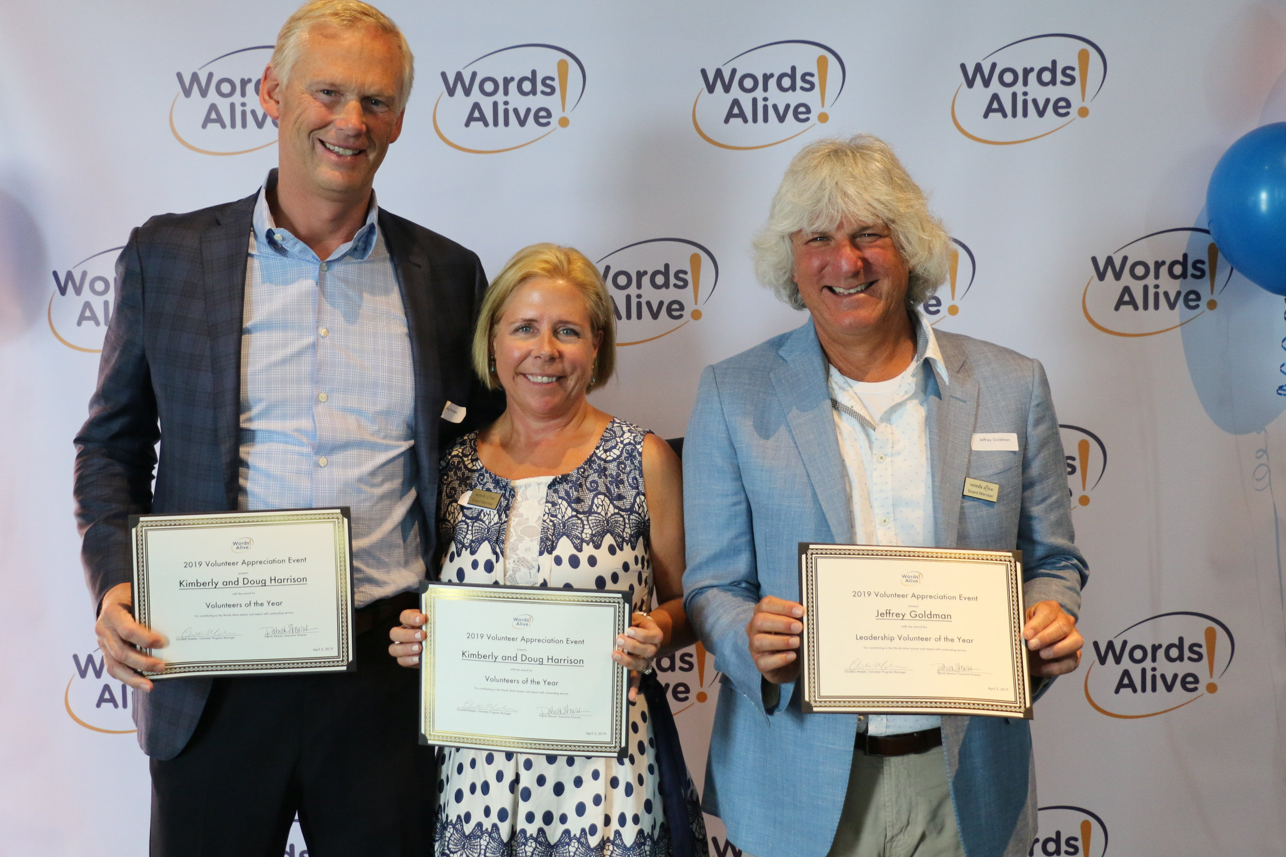 An image of Volunteers of the Year, Kim & Doug Harrison, with Leadership Volunteer of the Year, Jeffrey Goldman!