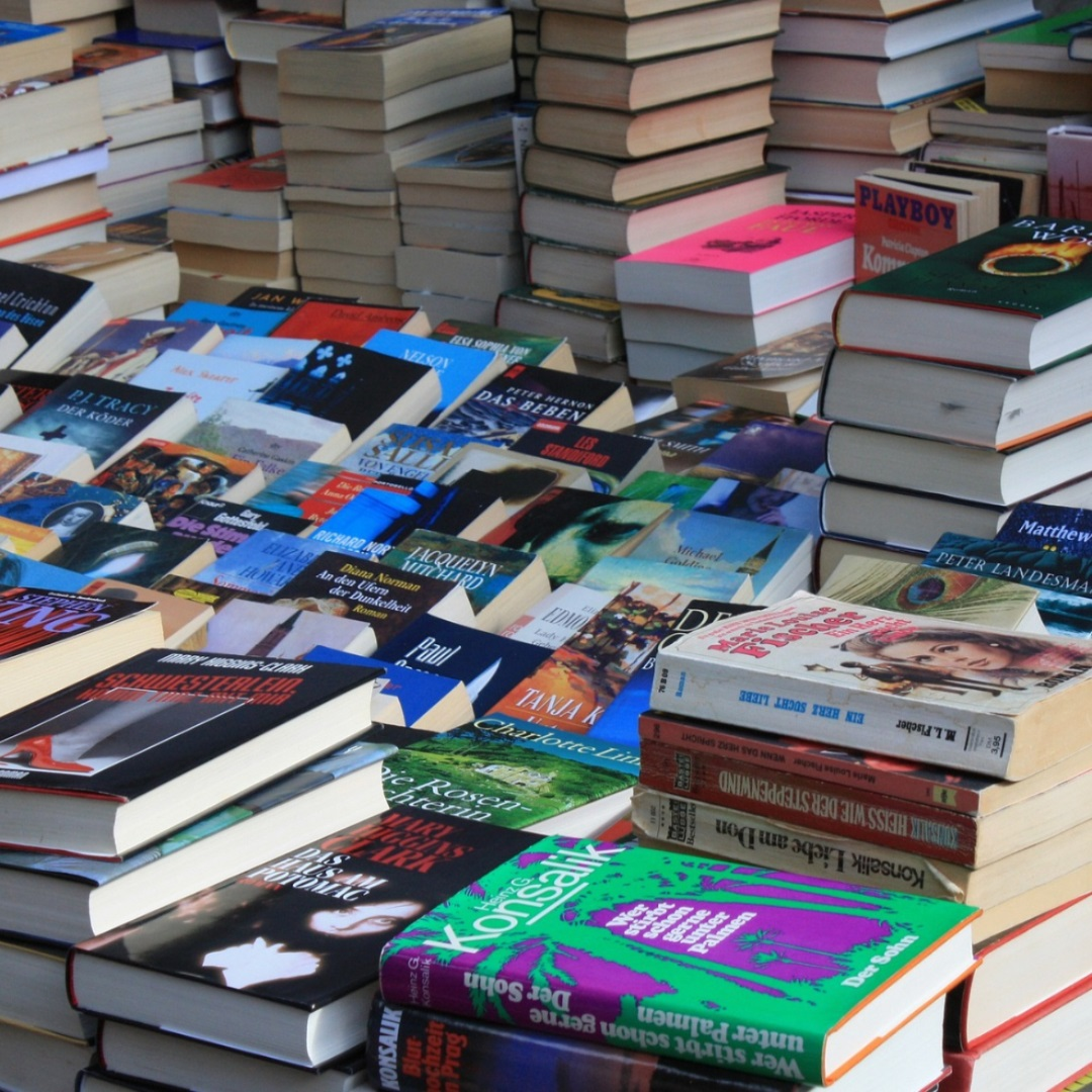 An image of books laying on a table.