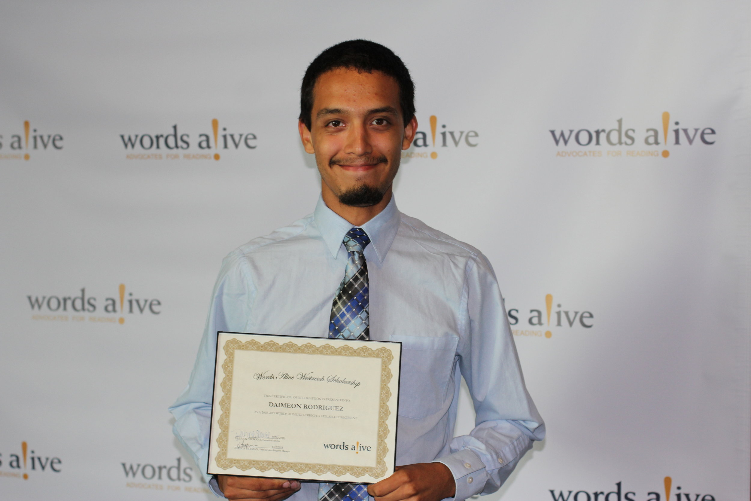 An image of Daimeon Rodriguez with his award at the 2018 Words Alive Westreich Scholarship Ceremony.