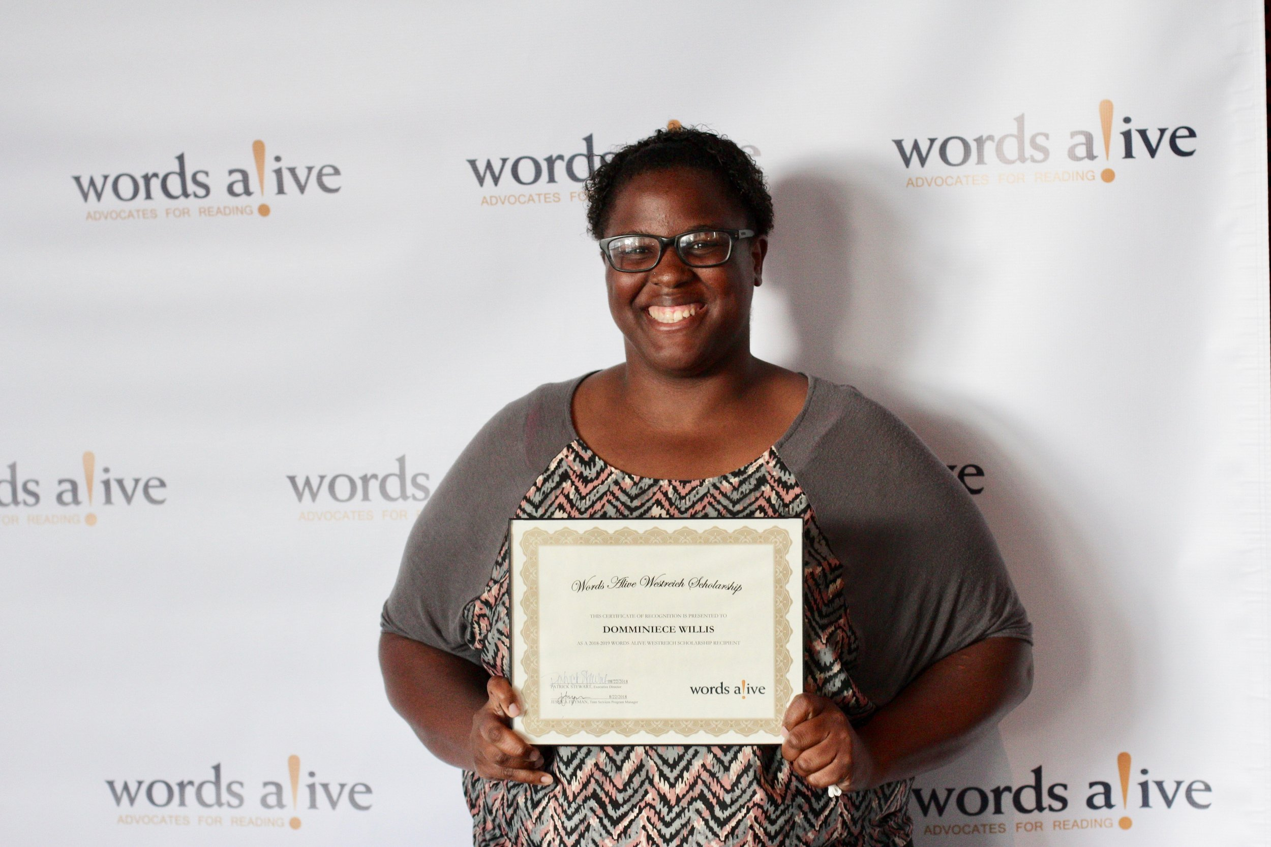 An image of Domminiece Willis standing at the 2018 WAWS Award Ceremony.
