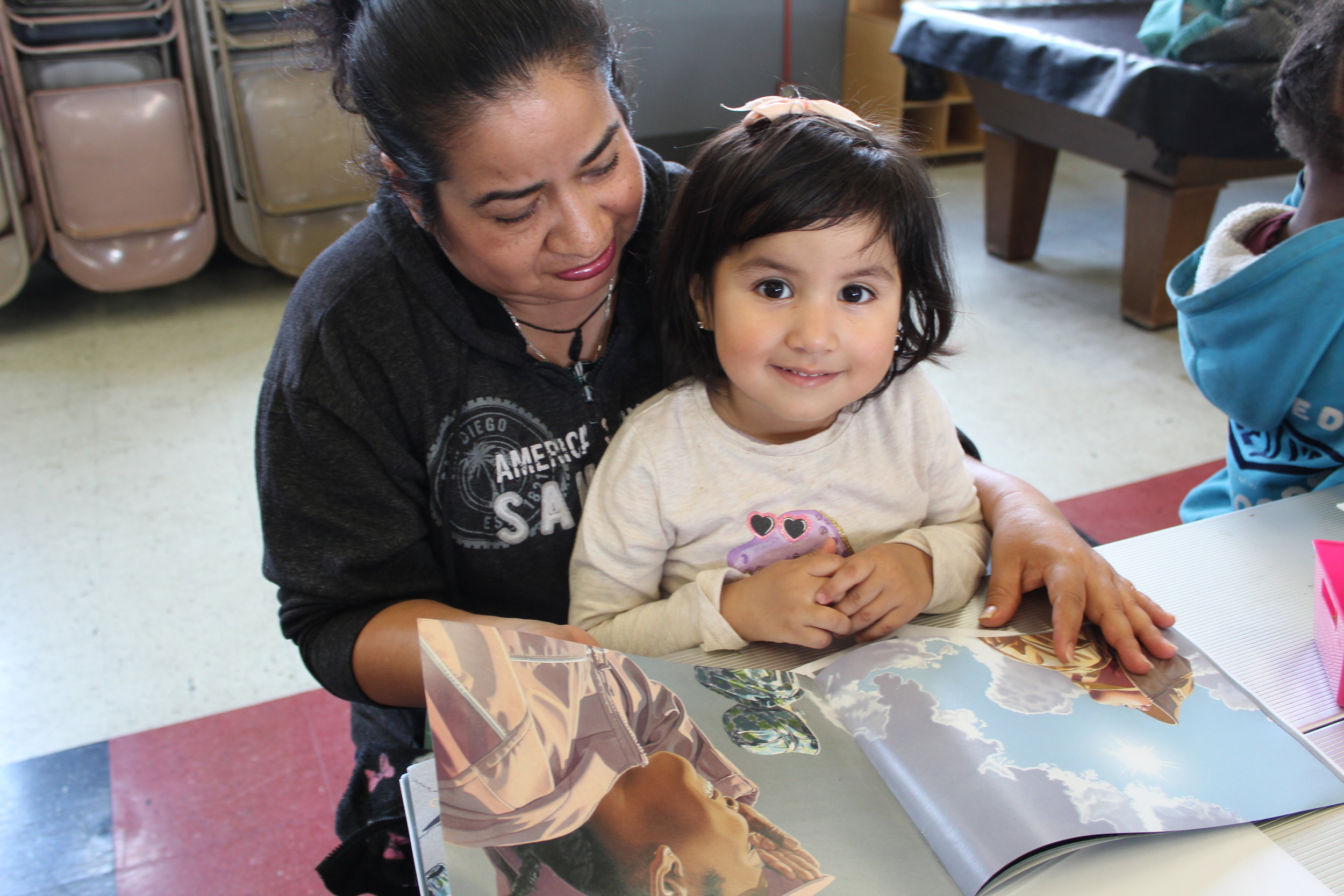 An image of a child and parent reading together in our Family Literacy Program.