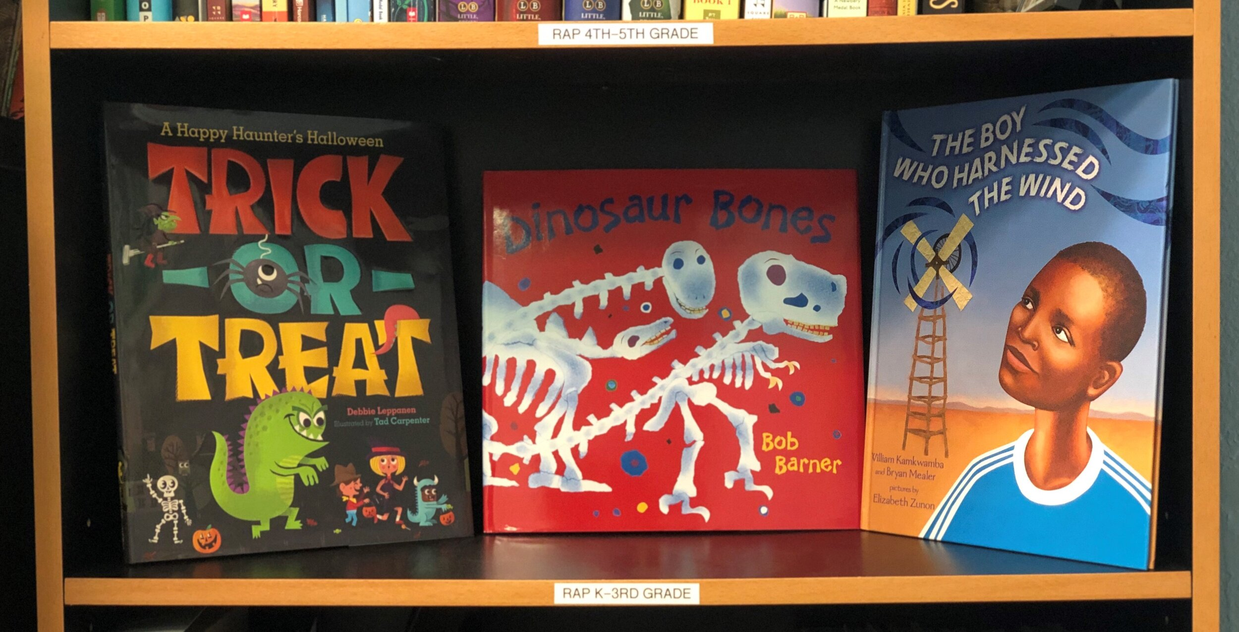 An image of three of our RAP books:  Trick-or-Treat: A Happy Hunter's Halloween, Dinosaur Bones,  and  The Boy Who Harnessed the Wind.