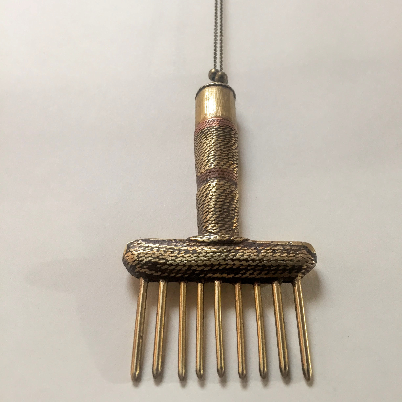 brass hair pick