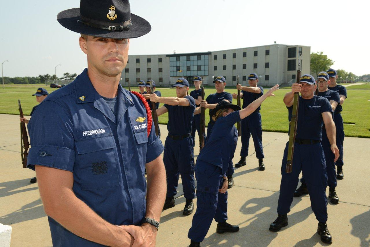 Photograph of USCG Chief Fredrickson in his role of Company Commander at TRACEN Cape May. Company Commanders are key members of the training command at TRACEN Cape May and do everything from train recruits on esprit de corps, mentor them on physical fitness, and break some of the bad personal habits we civilians think of as normal.  Source:  Official Blog of Training Center Cape May