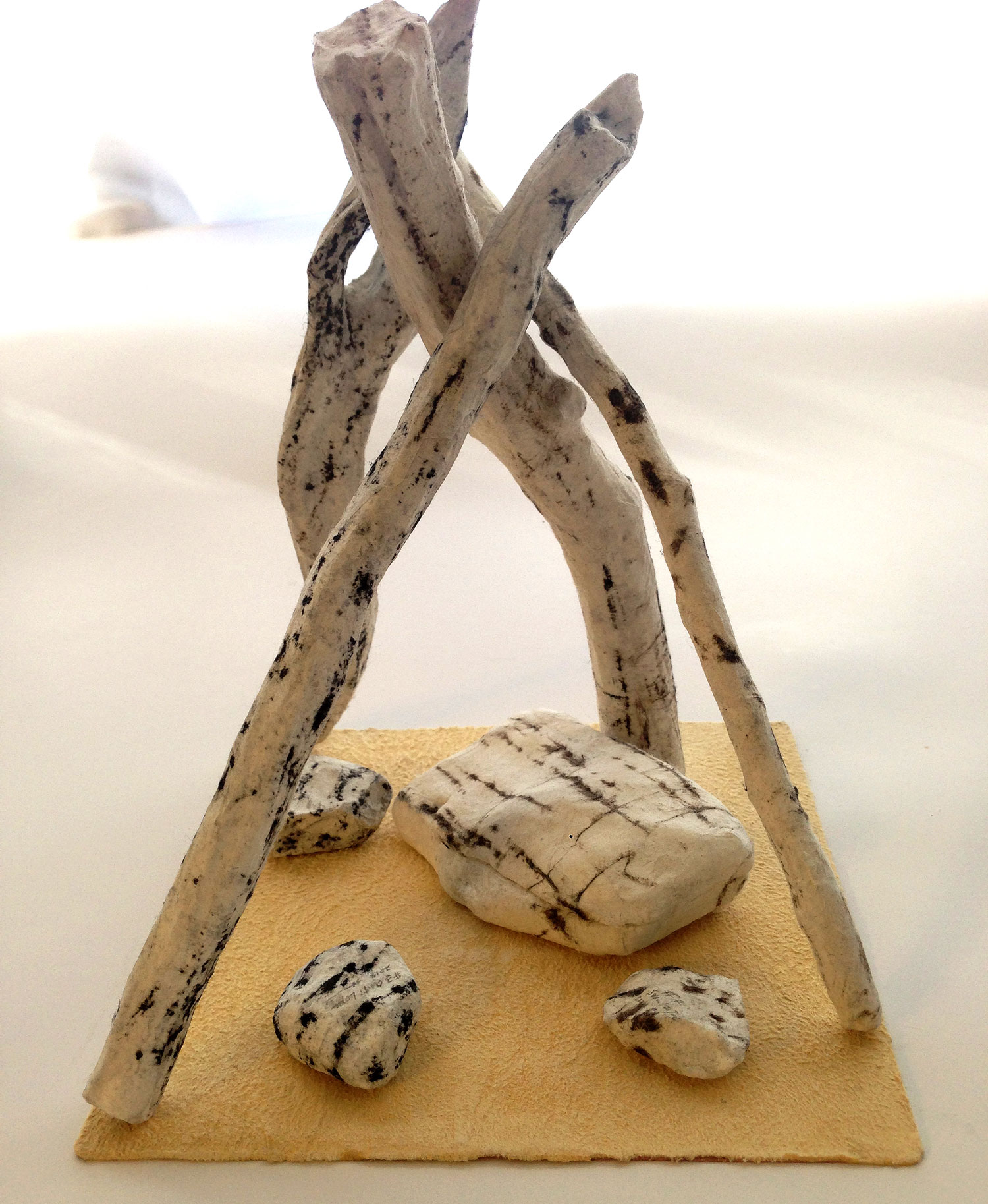 "Arizona Dream #1   (assembled)     2014  Tree branches, stones, charcoal, washi paper, copper, tanned leather   5.5"" x 5.5 x 6.5"""
