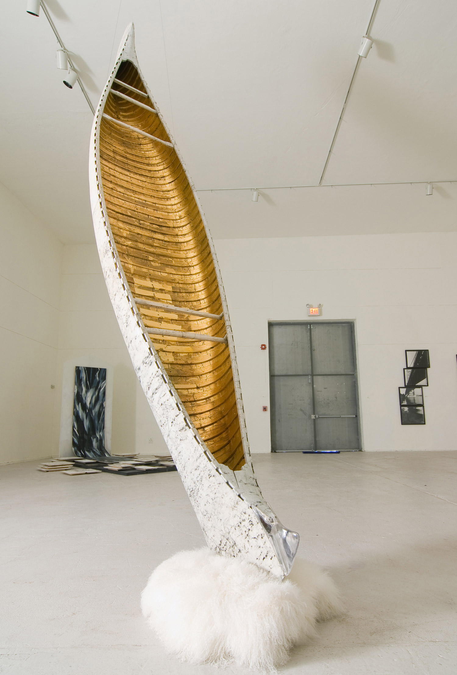 A Tipped Boat On A Warm Pedestal   2007  Wooden canoe, fur, resin, mineral pigment, gold leaf, charcoal, washi paper & wire