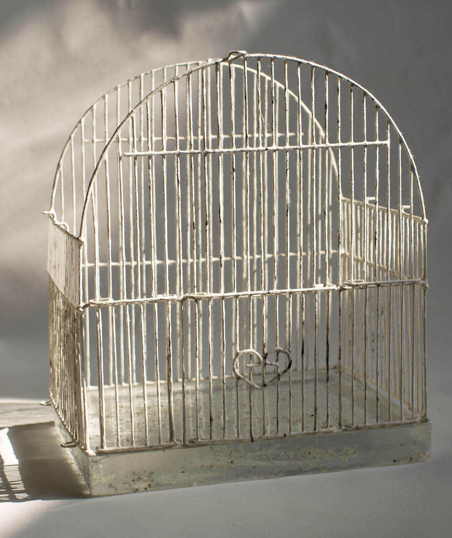 "Birdcage without roof #4   Metal, washi paper, charcoal, resin, dried grain 11.5"" x 8.5"" x 13.5"", 2010"