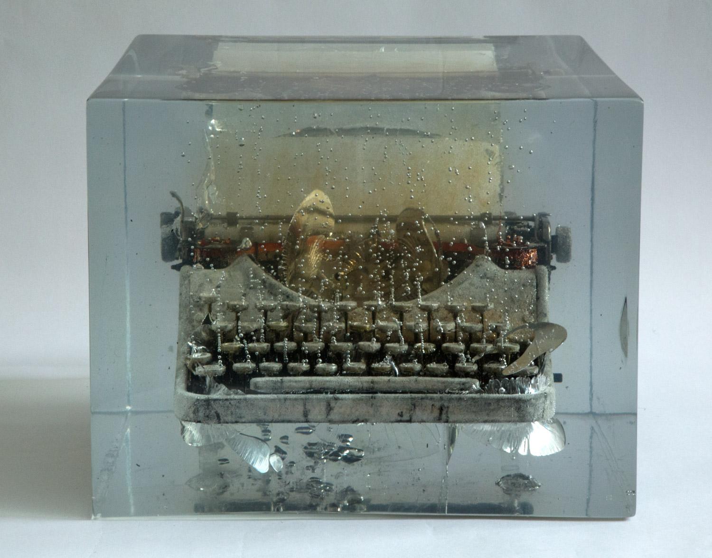 """Typewriter#2: """"I was defeated, yet...""""    2012  Charcoal,Washi, Typewriter, Resin  13.75"""" x 13.75"""" x 11"""""""