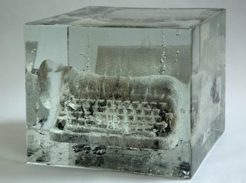 """Typewriter#5: """"I am here.""""    2012  Charcoal,Washi, Typewriter, Resin  13.75"""" x 13.75"""" x 11.5"""""""