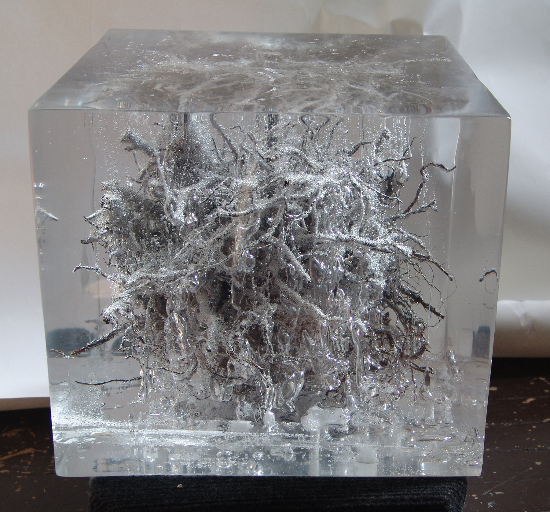 City Root #1   Another experimental cube, exploring bubbles in its chemical reactions, using an actual tree root.