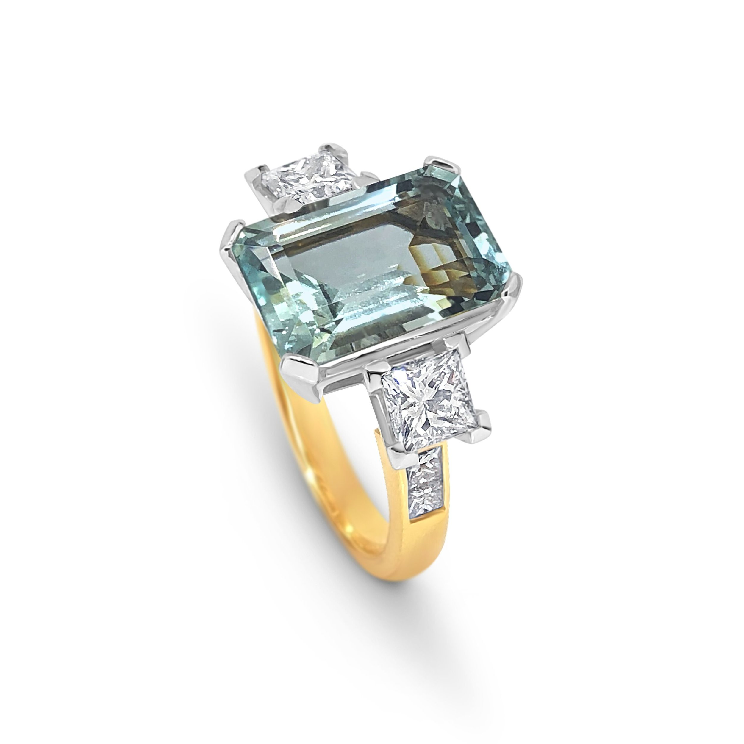 18ct yellow and white gold, aquamarine and diamond,  emerald cut aquamarine and princess cut diamond, trilogy .jpeg