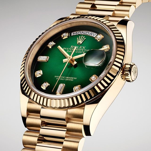 Rolex is introducing the new Oyster Perpetual Day-Date 36 in 18kt yellow gold which features a green ombré dial. It is embellished with diamond hour markers in 18kt gold settings; the diamonds at 6 and 9 o'clock are baguette-cut, a configuration specific to the Day-Date range. #Rolex #DayDate
