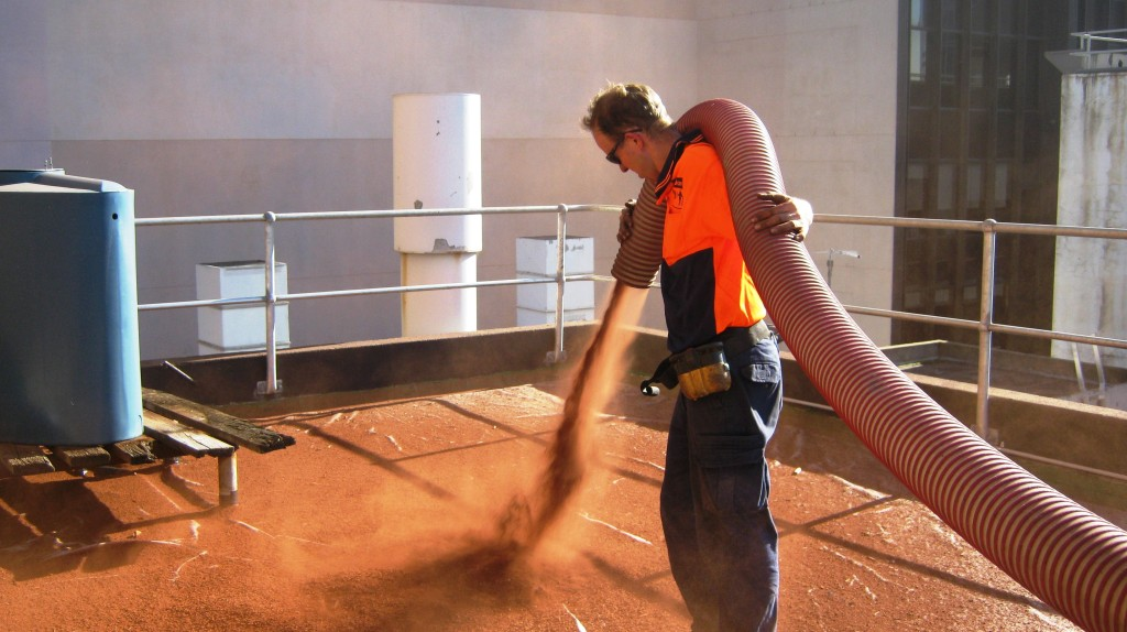 Blowing green roof substrate into place.   Image Source: Growing Green Guide