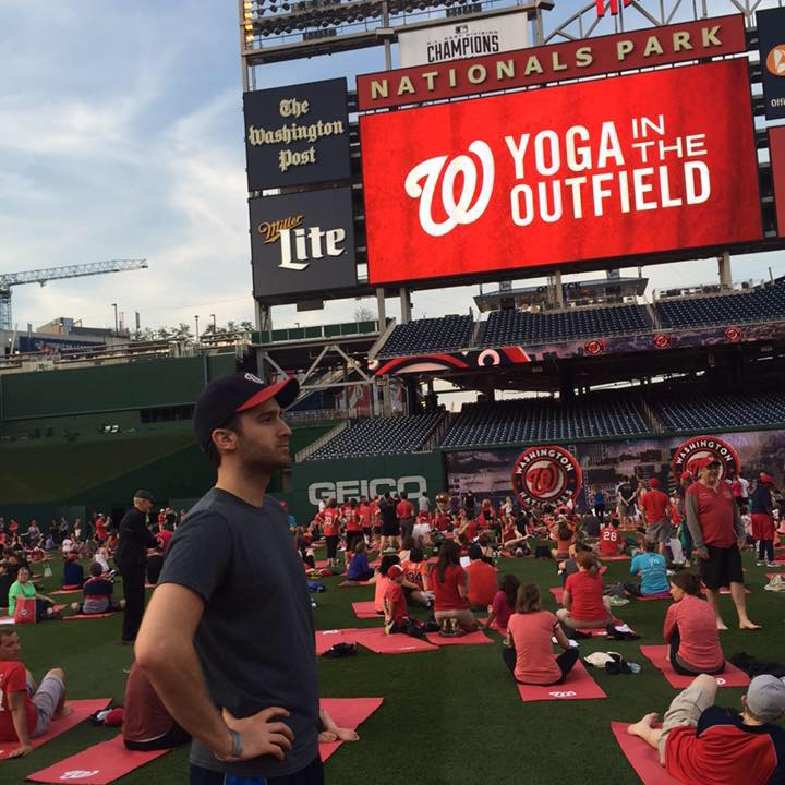 """A proud day in my life. The day I was FINALLY able to touch the blades of grass in the outfield at Nats Park. """"Yoga"""" was just an excuse to get onto the field. That's how far I was willing to go just to say I could stand where the pros stand, smell what the pros smell, and secretly dig up some of the grass to take home to my Nationals shrine."""