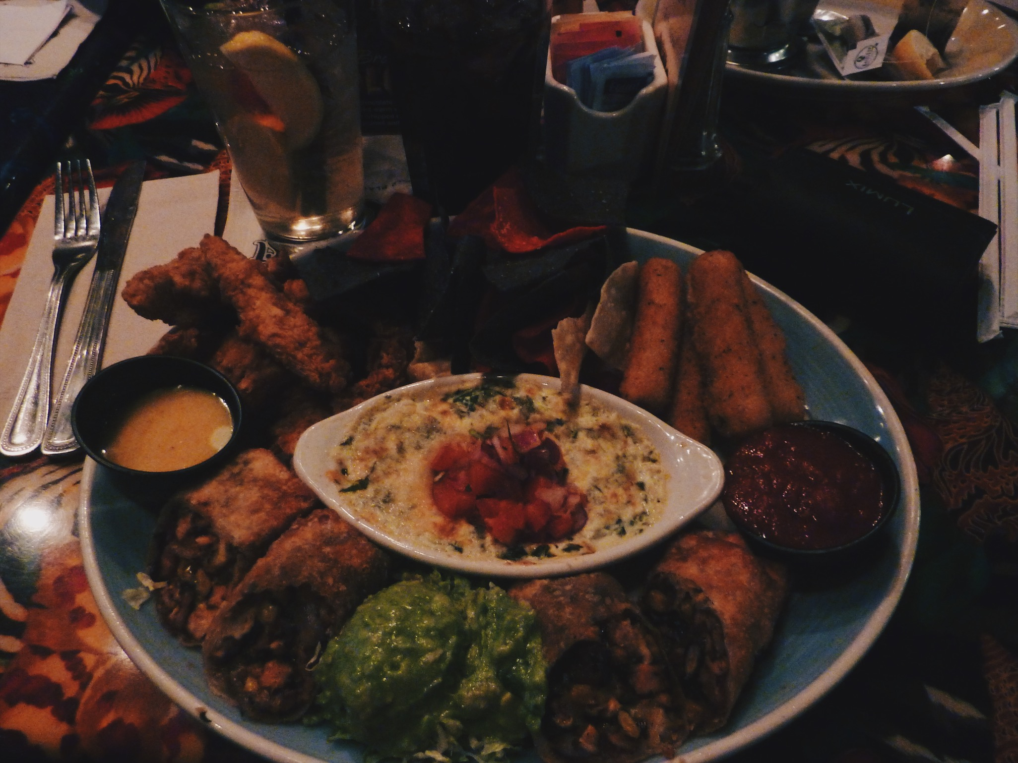 This appertizer we shared with a bigger group one year and it was so yummy! AWESOME APPETIZER ADVENTURE; Chimi-Cha-Chas, Spinach & Artichoke Dip, Cheese Sticks, Chicken Strips, guacamole