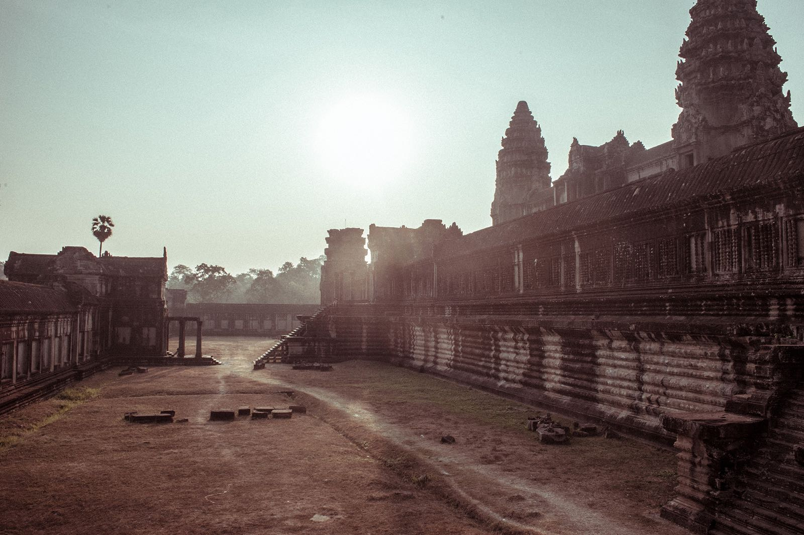 A peaceful morning at the Angkor Temples in Cambodia. With no one around her, it was just her and the antique stones