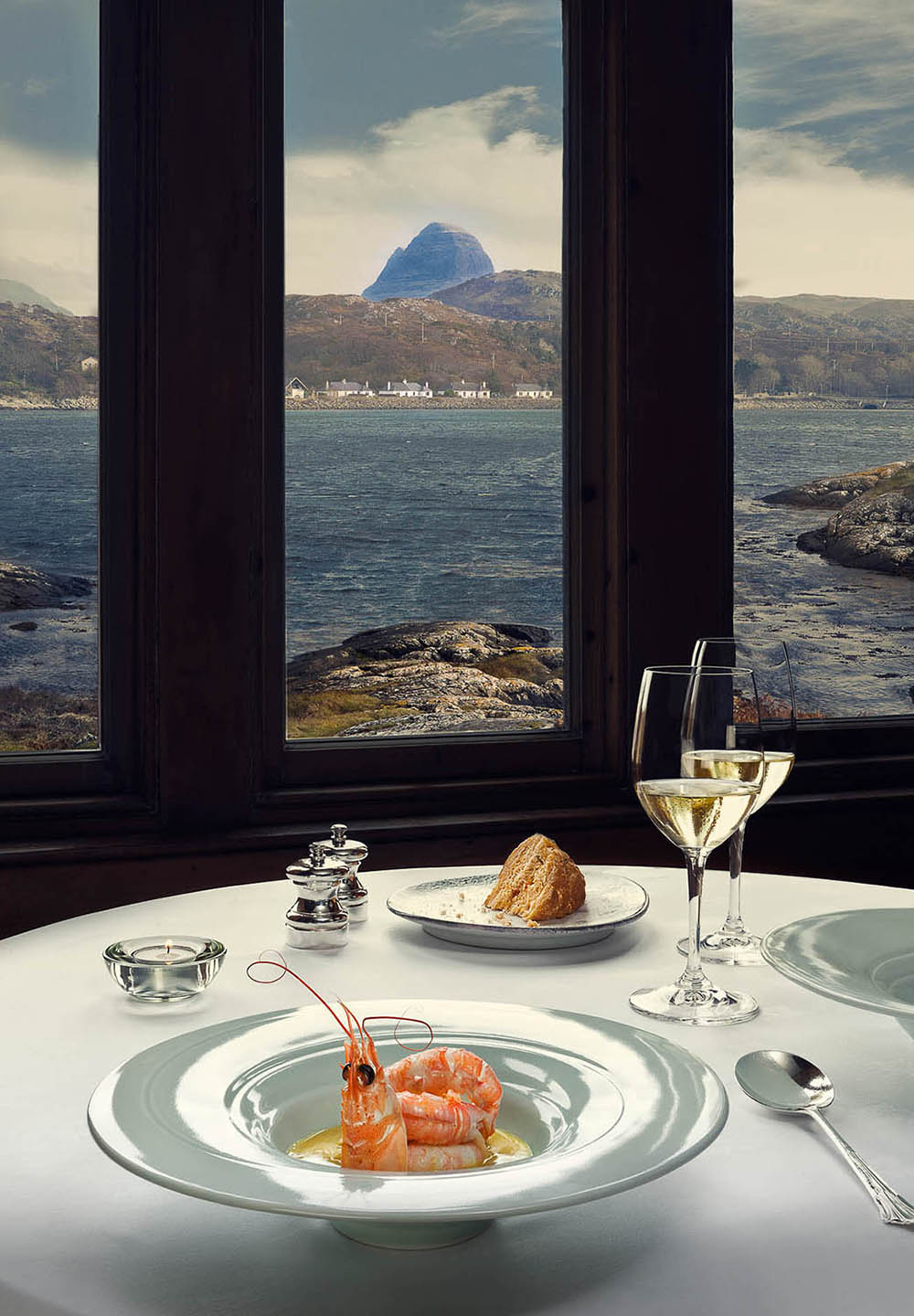 Prawns at Michelin starred The Albannach -  Iconic Suilven provides an ideal backdrop in this Scottish Government commissioned image.