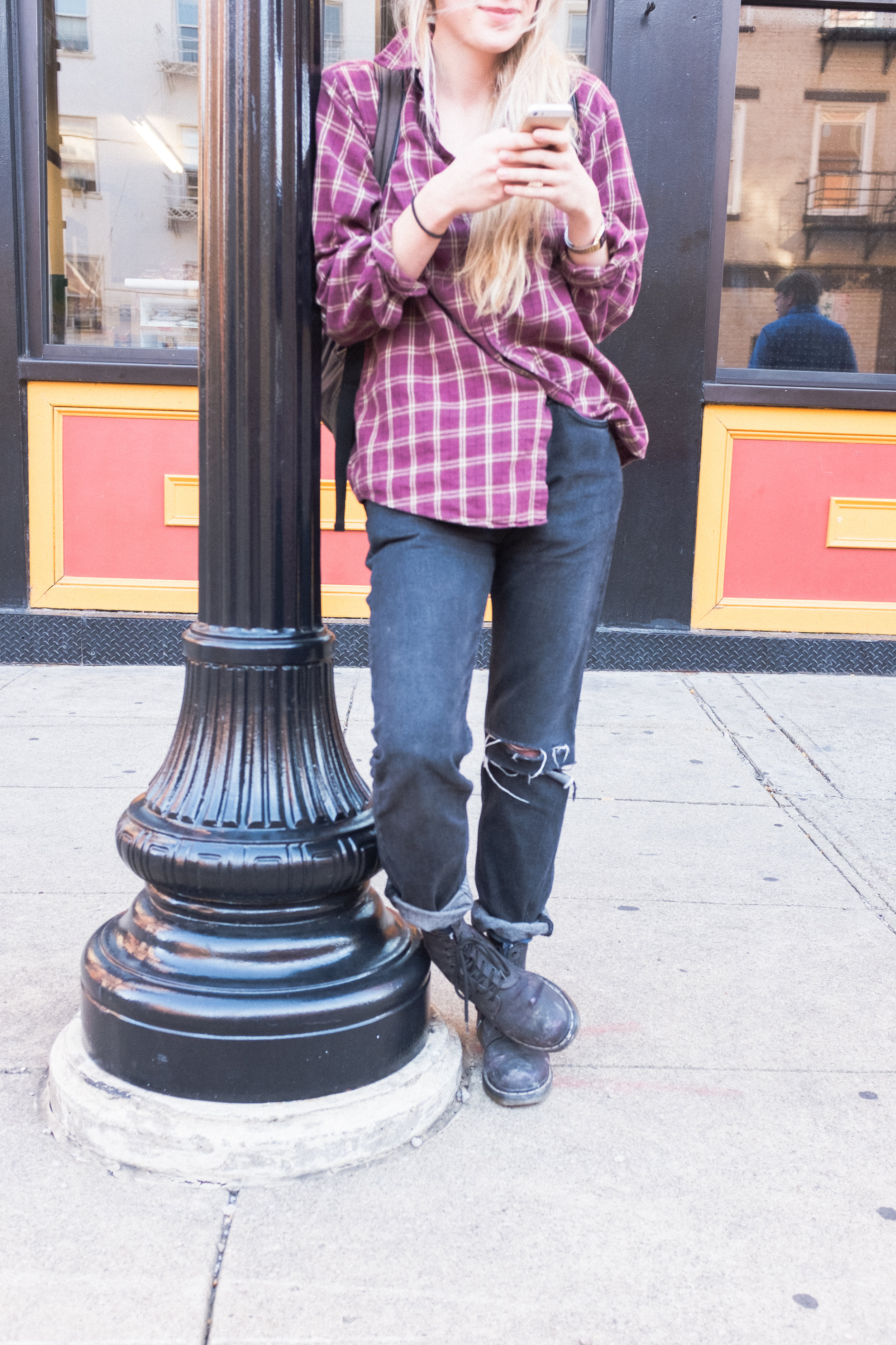 Ashley is wearing flower-print Doc Martins that she painted over with black paint. Because sometimes you want to change your style, but not your boots.