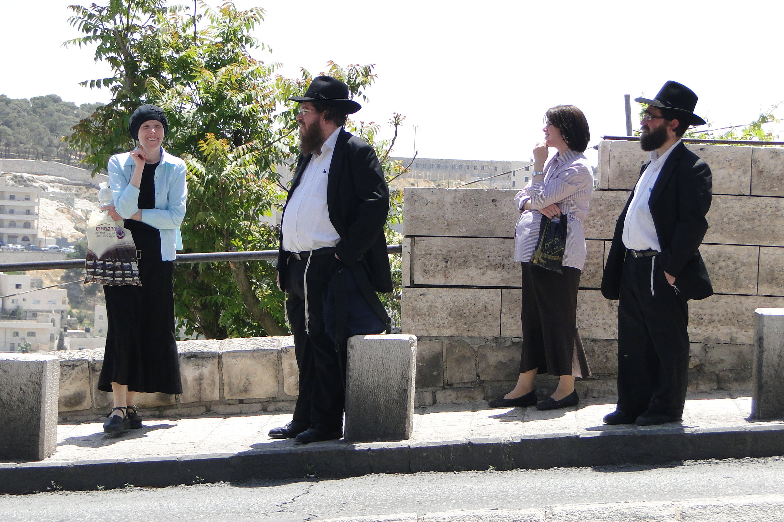 Haredi_(Orthodox)_Jewish_Couples_at_Bus_Stop_-_Outside_Old_City_-_Jerusalem_-_Israel_(5684561290).jpg