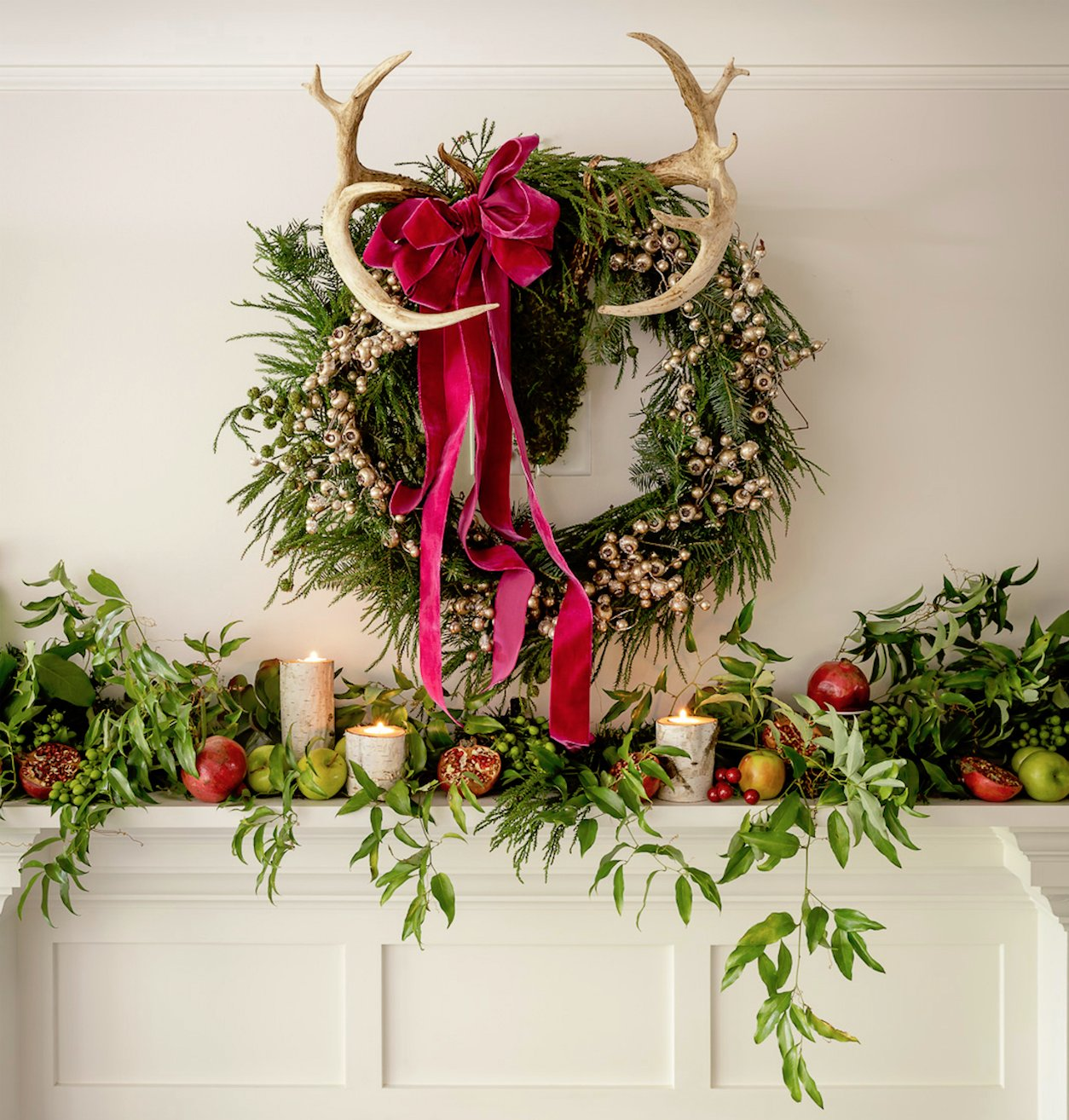 The mantle features local foliage, pomegranates, and apples.