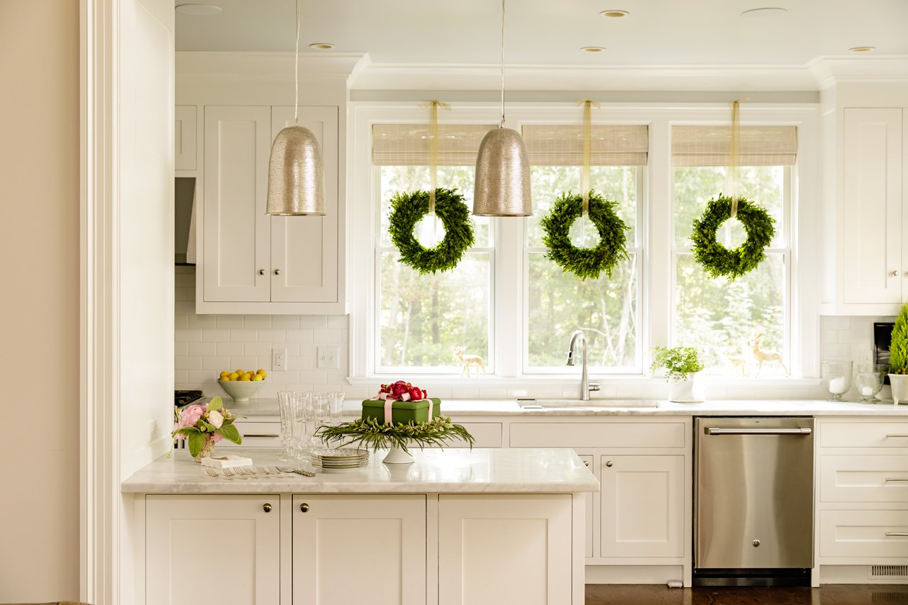 Boxwood wreaths in the kitchen.