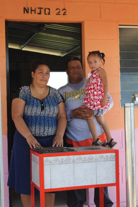 Here is Don Felix with his family in front of their house with their new kitchen.