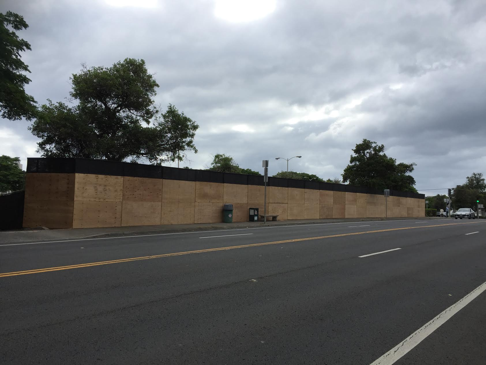 Here is what the original plywood barricade looked like. It's going to be so much better with art on it! Please also visit:  www.hawaii.edu/art/art-at-large/  to see more images and read the various artists' statements about their individual pieces.