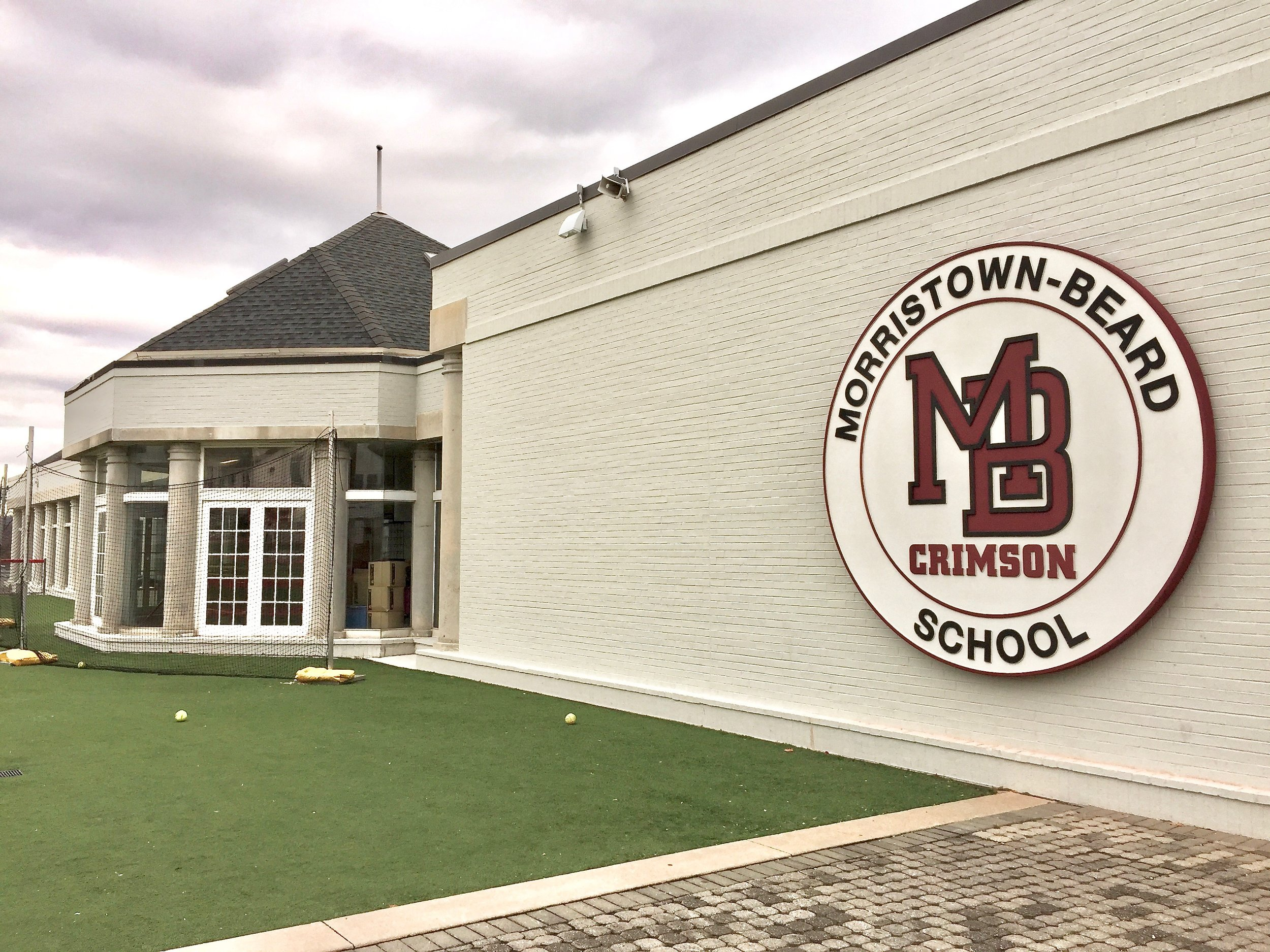 We were commissioned by Morristown-Beard School, a private school in Morristown, NJ to to carve and install this large scale medallion to face its main building and athletic field. It was carved out of flexible foam and given a flexible hardcoat with a stucco finish on top making it blend in perfectly with its painted masonry background. The flexible core of this carved sign allow it to take an occasional hit from from a foul ball and bounce back as if nothing happened. Basiically it looks great and can take a punch.