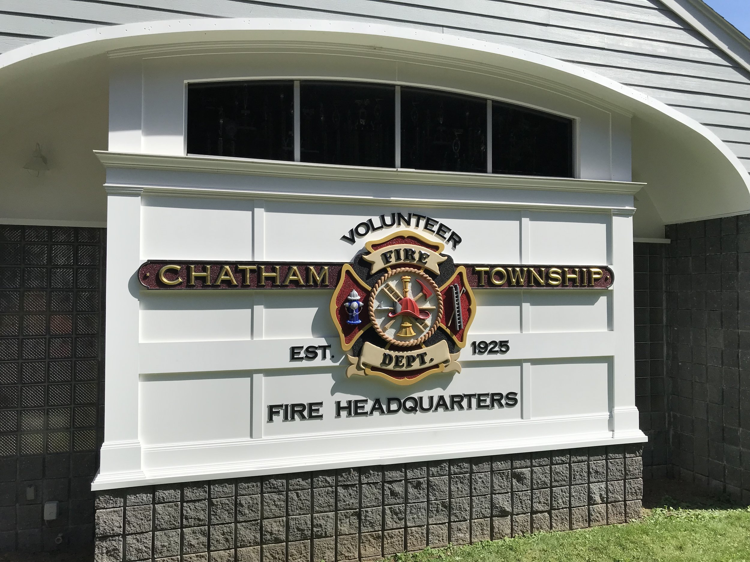 Today we completed a complex handcrafted sign for Chatham Township Fire Station 1. If features a fully sculpted Maltese cross with crushed glass smalts giving it that great sparke! CHATHAM TOWNSHIP is a prismatic letter with 23.5K gold leaf imported from Italy. The letters are black dibond mounted on an Azek paneled background. It's quite a stunning display especially on a beutiful sunny day like today!