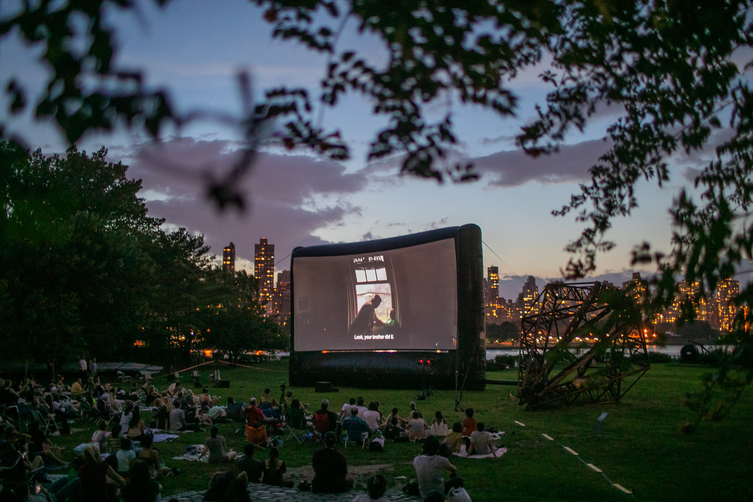 An outdoor film at Socrates Sculpture Garden in Astoria, Queens photographed for the Arts & Leisure section.