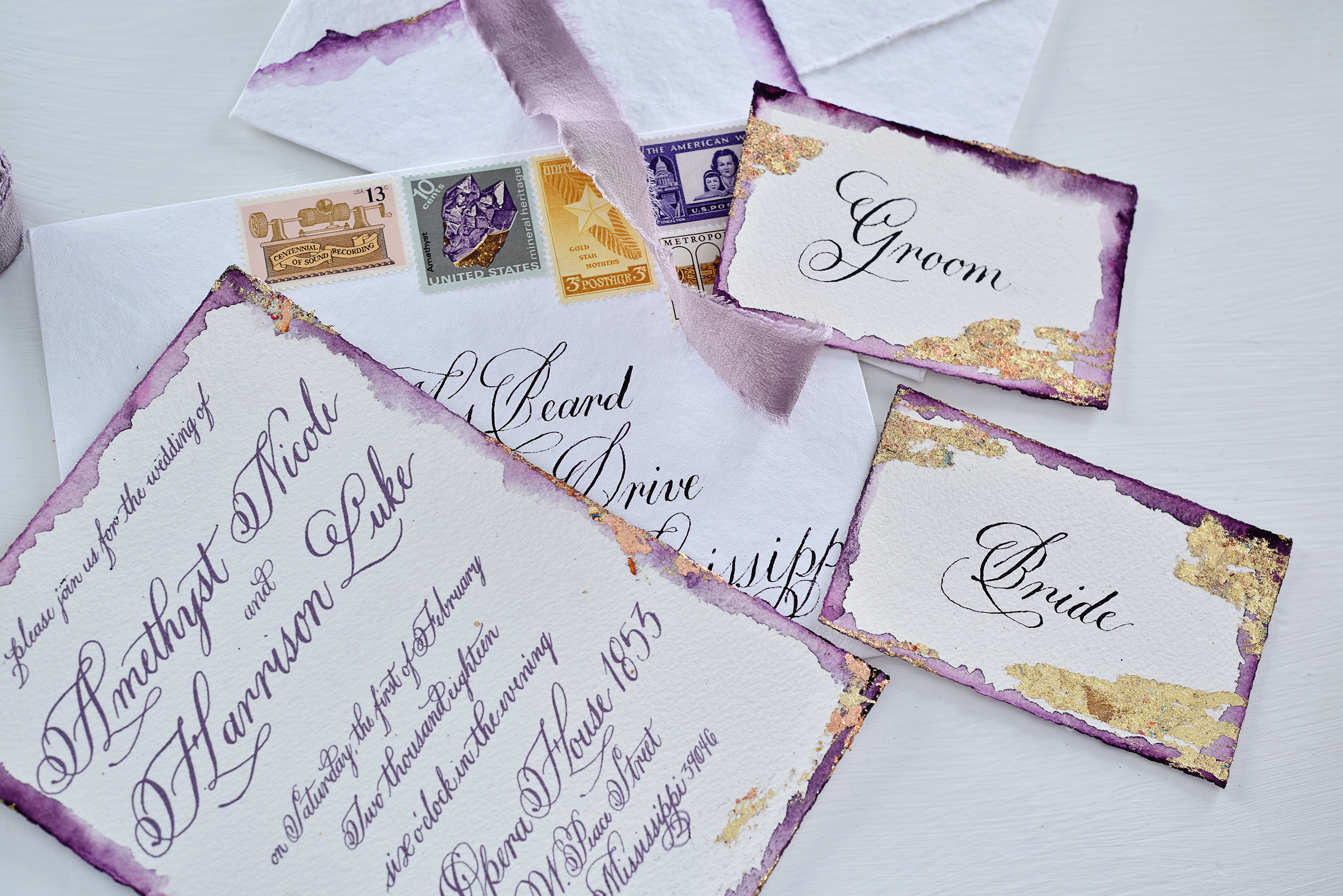 Wedding Invitation Suite featuring deckled and watercolor dipped edges and gold leafing. Photo courtesy of  Lori Michelle Photography .