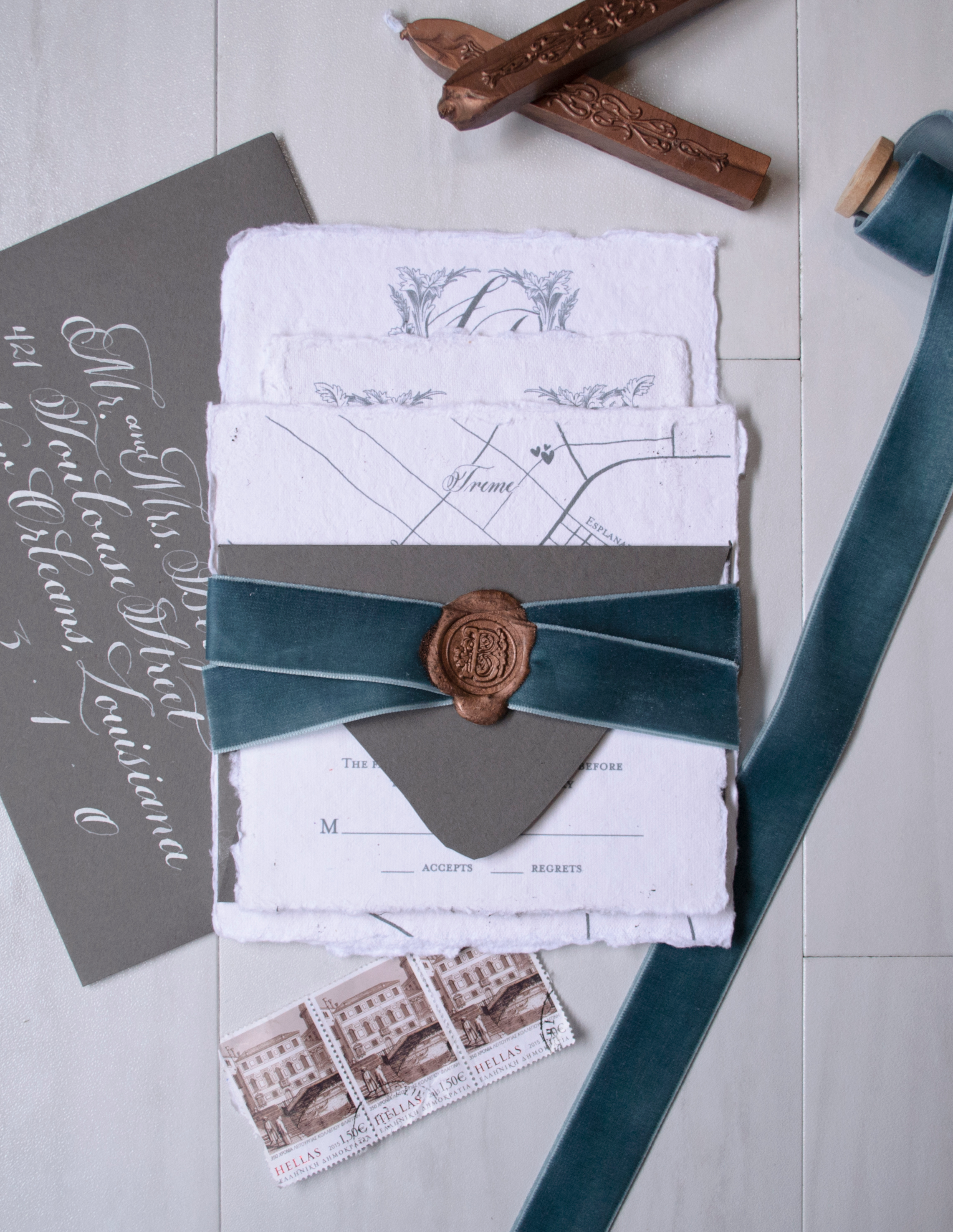 Wedding Invitation Suite printed on handmade paper w/velvet ribbon wrap and a wax seal enclosure.