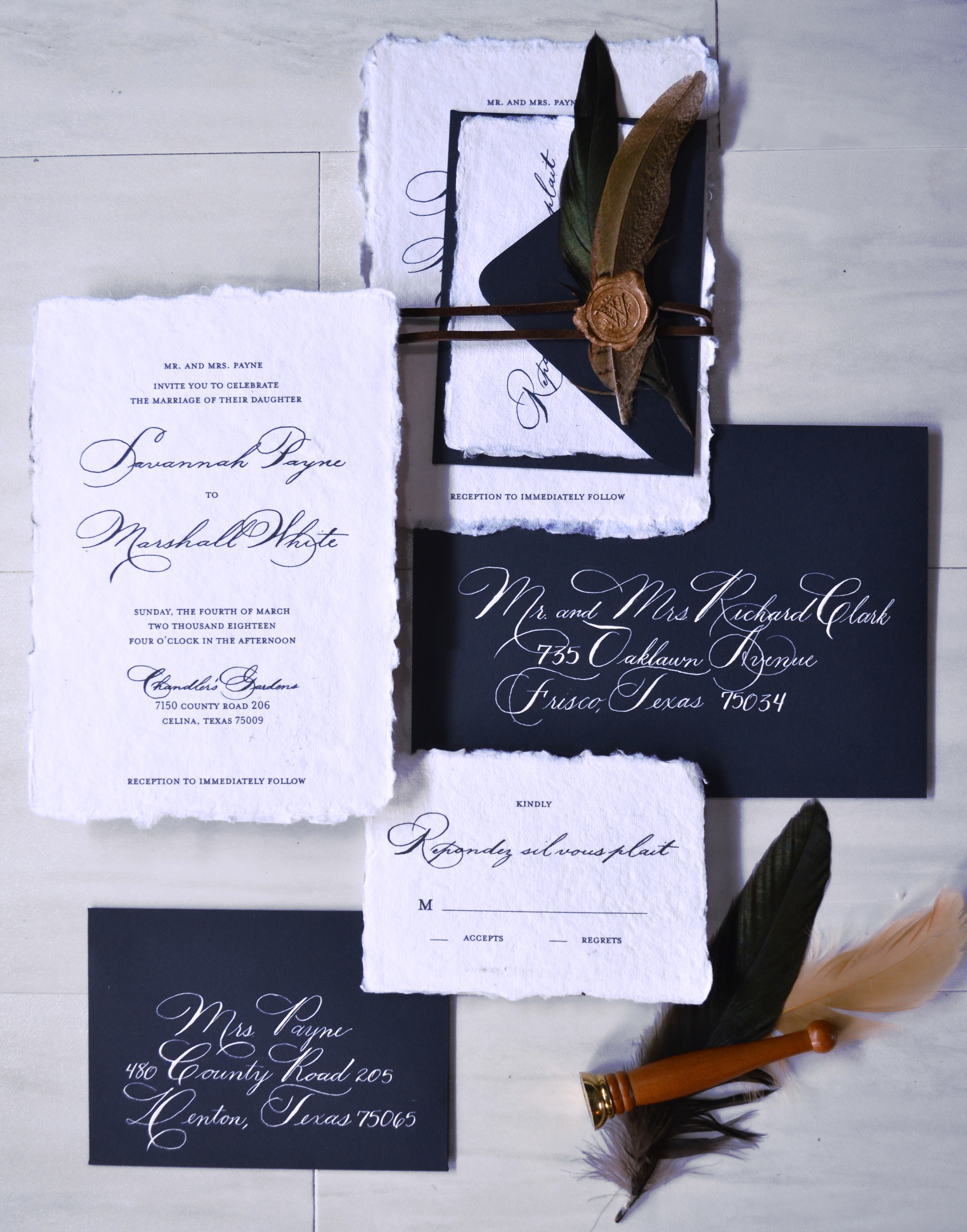 Wedding Invitation Suite w/handmade paper, a leather wrap, feathers, and a wax seal enclosure.