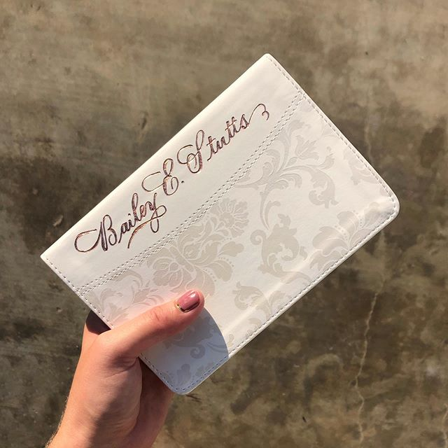 A tiny, yet bold, name foiled on a Bible as a gift to a recent bride. This rose gold foil on white just might be my favorite color combinations so far. . #calligraphy #foiled #foiledcalligraphy #foiledbible #custombible #bridalgift #bridesbible