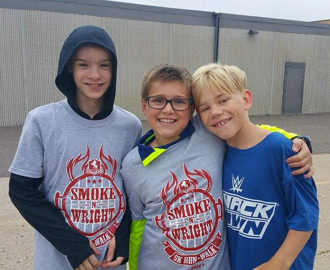 Carson pictured with two of his friends. Nick (left) and Carson (center) like to play Nerf Guns together. Peter (right) and Carson enjoyed basketball at recess.
