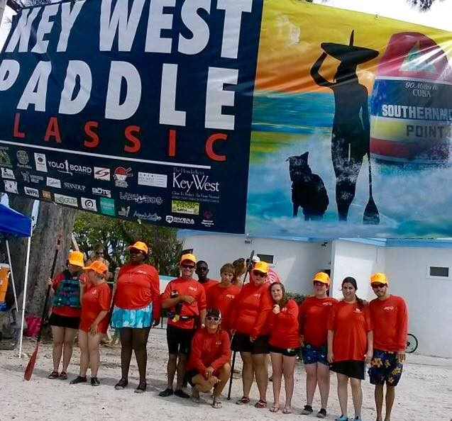 Lazy Dog owner, Sue, pictured with athletes of Key West Paddle Classic.