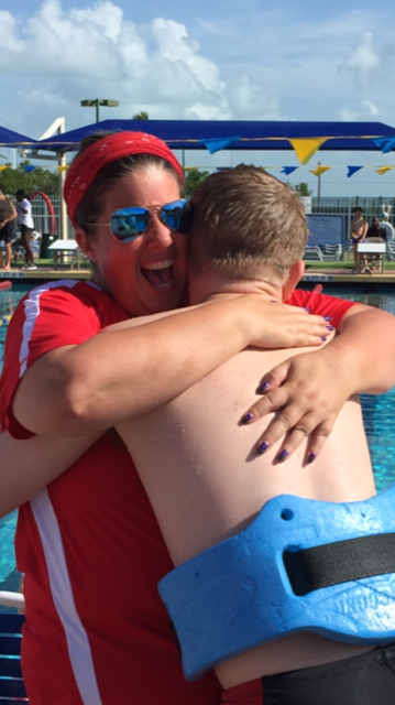 Laurie Skinner hugging a Special Olympics Monroe County swimmer after he competed at the 2017 State Games